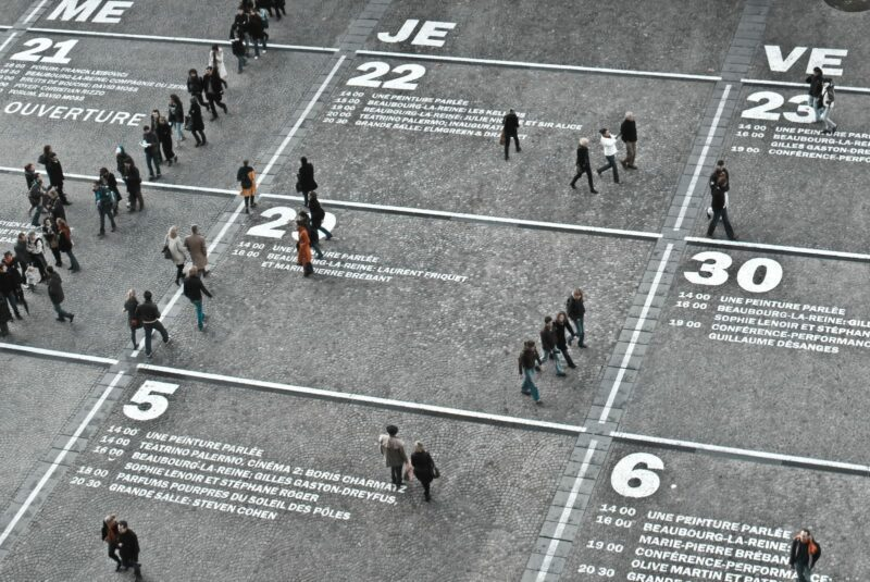 People walking over numbers